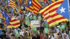 Marchers wave Catalonian nationalist flags on Catalan National Day in Barcelona on September 11th, 2012. Photograph: Reuters/Albert Gea