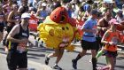 A participant runs in fancy dress during the 2018 London Marathon. Photograph:   Niklas Halle'nniklas/AFP/Getty Images