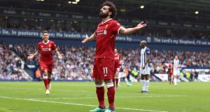 Liverpool's Mohamed Salah celebrates scoring his side's second goal during their Premier League win over West Bromwich Albion. Photo: Nigel French/PA Wire