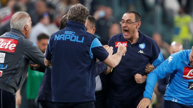 Napoli coach Maurizio Sarri celebrates after the match with his coaching staff. Photo: Stefano Rellandini/Reuters