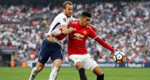 Manchester United's Chris Smalling in action with Tottenham Hotspur's Harry Kane during the FA Cup semi-final at Wembley. Photo: John Sibley/Reuters