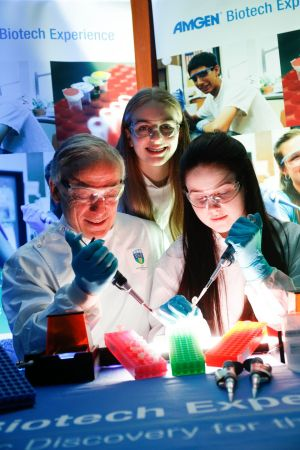 BIOTECH EXPERIENCE: Minister for Education Richard Bruton with Melody McGuirk and Alannah Fagan from Rockford Manor Presentation Secondary School, Blackrock, Co Dublin, at the Amgen Biotech Experience Global Conference in the Herbert Park Hotel, Dublin. It was announced that 13,500 secondary students are to participate in the Amgen Biotech Experience over the next three years. Photograph: Conor McCabe Photography