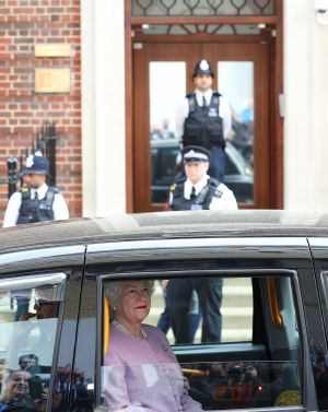DOTING GRAN? A person impersonating Britain's Queen Elizabeth is driven past the Lindo Wing of St Mary's Hospital after Britain's Catherine, the Duchess of Cambridge, gave birth to a son in London. Photograph: Hannah McKay/Reuters