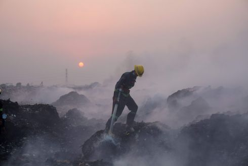 YANGON BURNING: A fireman battles a huge fire at a massive garbage dump in Yangon, Myanmar, that raged for hours, blanketing a large part of the city in foul-smelling smoke. Photograph: Sai Aung Main/AFP/Getty Images