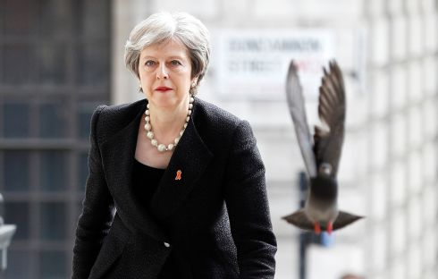 MEMORIAL SERVICE: A pigeon flies ahead of Britain's prime minister Theresa May as she arrives at a service at St Martin-in-The-Fields church in London to mark 25 years since the high-profile murder of Stephen Lawrence in a racially motivated attack. Photograph: Peter Nicholls/Reuters