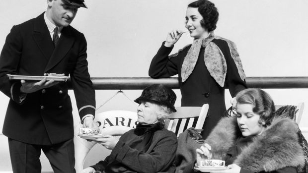 Three women being served tea by a steward on board an ocean liner crossing the Atlantic ocean in the 1920s. Photograph: H. Armstrong Roberts/ ClassicStock/ Getty Images