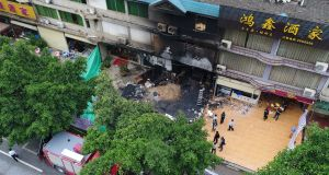 An aerial photo shows the aftermath of a deadly fire at a karaoke bar in Yingde city, China. Photograph: Deng Hua/Xinhua News Agency via AP