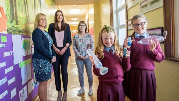 Fiona Rose Redmond (10), left, and Ava McCord (10) with Lorraine Nolan Daly, Lorna Diffley, principal, and Paula Byrne of the Parents' Association at St Brigid's Girls National School, Killester, Dublin. Photograph: Brenda Fitzsimons / THE IRISH TIMES