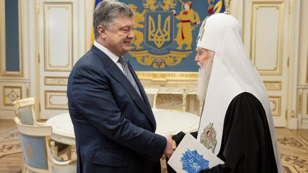 "Ukrainian president Petro Poroshenko with Patriarch Filaret, head of Ukraine's Orthodox Church in Kiev: The bid to secure independence ""will cause a huge upsurge in the national spirit"". Photograph: Mikhail Palinchak/Ukrainian Presidential Press Service"