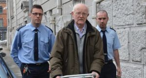 Fr John Calnan, pictured here during an earlier court appearance, was given an 18 months suspended prison sentence for the abuse of three girls between 1974 and 1978. Photograph: Michael Mac Sweeney