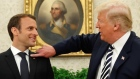 Trump cleans 'dandruff' off Macron's shoulder in awkward exchange