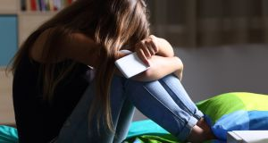 The proportion of students who felt upset or threatened due to social media or internet postings was highest in the girls' school. File photograph: Getty Images
