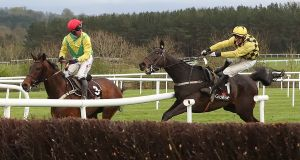 Al Boum Photo, ridden by  Paul Townend (right), collides with Finian's Oscar, ridden by  Robbie Power,  during day one of the Punchestown Festival in Co  Kildare. Photograph: Niall Carson/PA Wire