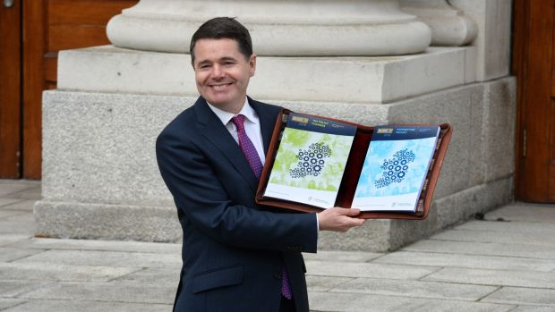Minister for Finance Paschal Donohoe with his budget book at Government Buildings last year. A new report hints at changes to the carbon tax and 9 per cent VAT rate for hospitality businesses. File photograph: Cyril Byrne/The Irish Times