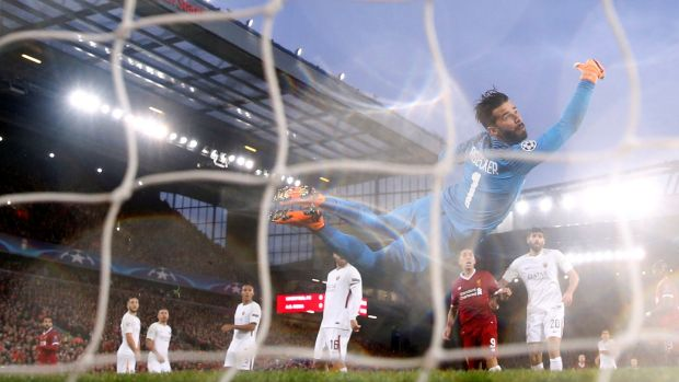 Roma's Alisson Becker can't prevent Mohamed Salah from opening the scoring at Anfield. Photograph: Carl Recine/Reuters