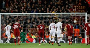 Roma's Diego Perotti scores their second goal from the penalty spot during the 5-2 defeat to Liverpool in the Champions League semi-final first leg at Anfield.  Photo: Phil Noble/Reuters