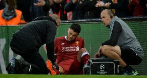 Liverpool's Alex Oxlade-Chamberlain will miss the rest of the season and England's World Cup campaign after suffering knee ligament damage in the Champions league semi-final first leg against Roma on Tuesday. Photograph: Peter Powell/EPA