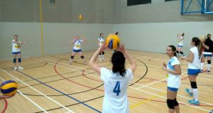 The Garda Volleyball Club women's team at training in in the sports hall of Coláiste na hÍde in Tallaght.