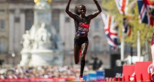 Vivian Cheruiyot of Kenya celebrates after crossing the finish line to win the elite women's race in the London Marathon. Photograph:   Justin Setterfield/Getty Images