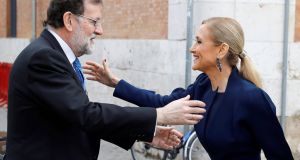 Spanish prime minister Mariano Rajoy greets the president of Madrid's regional government Cristina Cifuentes  at the Alcala de Henares University, near Madrid, earlier this week. She resigned from the presidency on Wednesday. Photograph: Juan Carlos Hidalgo/AFP/Getty Images