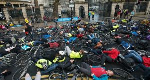 "Cyclists held a ""Die-In"" outside the Dail today in protest at the latest death of a cyclist on the Dublin streets. Photograph: Dave Meehan/The Irish Times"
