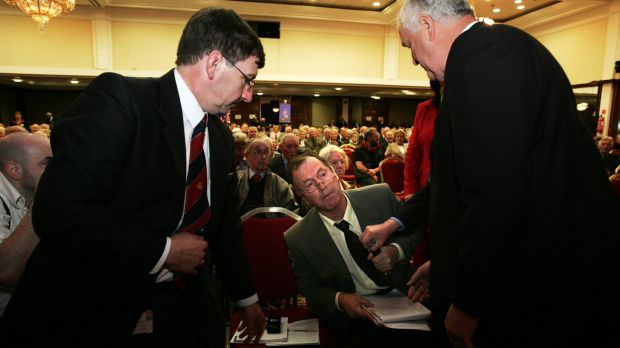 Security staff cover the microphone of shareholder Patrick Kehoe fron Wexford at the 2005 AIB Group AGM in Dublin. Mr Kehoe was asked to to leave the meeting after the AIB chairman Dermot Gleeson deemed that he was disrupting the meeting. Photograph: Frank Miller