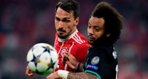 Bayern Munich's Mats Hummels vies for possession with Real Madrid's Marcelo during the Champions League semi-final first-leg match at the Allianz Arena. Photograph: Javier Soriano/AFP/Getty Images