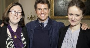 From left,  Fiona Fitzsimons, director of Eneclann and the Irish Family History Centre, actor Tom Cruise, and Helen Moss, senior researcher, Eneclann. Photograph: Fennell Photography