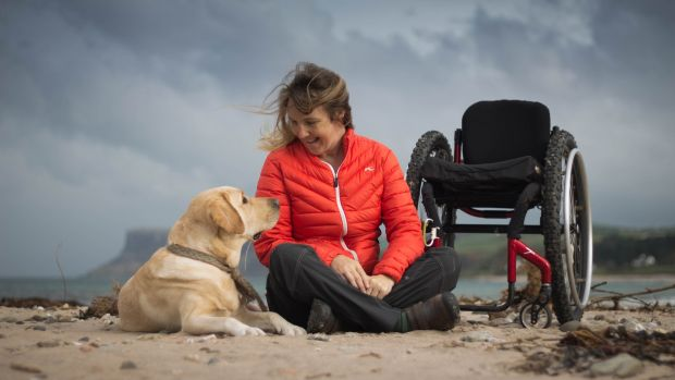 Chris Slavin and her service dog, Earle, on one of their many visits to Ireland. Photograph: Lyndsey G. Kidd