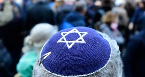 A participant of the 'Berlin wears a kippa' movement. Photograph:  AFP/ Getty Images