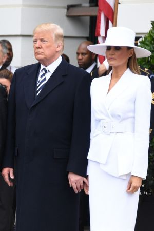 US President Donald Trump and First Lady Melania Trump  participate in a state welcome at the White House in Washington, DC, AFP PHOTO / JIM WATSONJIM WATSON/AFP/Getty Images