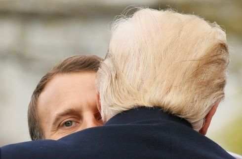 U.S. President Donald Trump and French President Emmanuel Macron hug during an arrival ceremony at the White House in Washington. REUTERS/Jim Bourg
