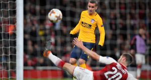 Atlético Madrid's Antoine Griezmann scores their late equaliser in the Europa League semi-final first leg against Arsenal at the Emirates Stadium. Photograph: Dylan Martinez/Reuters