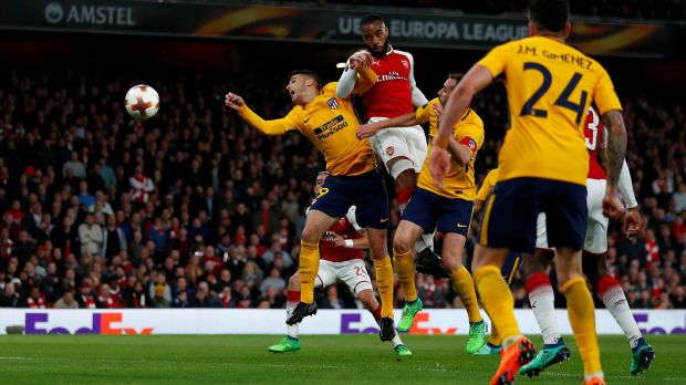 Arsenal striker Alexandre Lacazette heads home his side's goal in the Europa League semi-final first leg against Atlético Madrid at the Emirates Stadium. Photograph: Eddie Keogh/Reuters