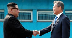 North Korean leader Kim Jong-unshakes hands with South Korean president Moon Jae-in  in the border village of Panmunjom, South Korea. Photograph: EPA