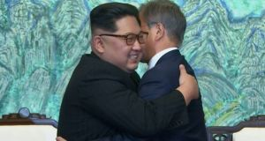 Kim Jong-un and Moon Jae-in embrace after signing on a joint statement at the border village of Panmunjom in South Korea. Photograph: Korea Broadcasting System via AP