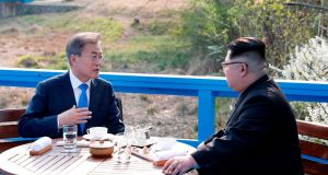 Moon Jae-in and  Kim Jong-un hold talks on a bridge next to the military demarcation line at the truce village of Panmunjom. Photograph:  Korea summit press pool via AFP/Getty Images