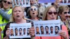 People shout slogans while holding signs during a protest outside the City of Justice  in Valencia, Spain on Friday. Photograph:  Heino Kalis/Retuers