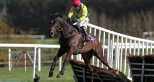 Supasundae ridden by Robbie Power clears the last on their way to winning the  Punchestown Champion Hurdle. Photograph: Brian Lawless/PA Wire