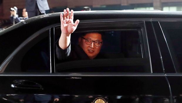 North Korea's leader Kim Jong-un waves in a car as he leaves for the North after a closing ceremony at the end of the historic summit with South Korea's President in Panmunjom. Photograph: Korea Summit Press Pool/AFP/Getty Images
