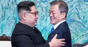 South Korean president Moon Jae-in and North Korean leader Kim Jong-un embrace at the village of Panmunjom inside the demilitarised zone separating the two Koreas. Photograph: Korea Summit Press Pool/Pool via Reuters