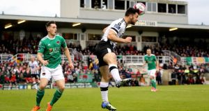 Conor McCarthy watches as Dundalk's Patrick Hoban heads the ball during Cork City's 1-0 win. Photograph: Ryan Byrne/Inpho