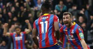 Wilfried Zaha celebrates scoring Crystal Palace's opener in their 5-0 rout of Leicester. Photograph: Ian Kington/AFP