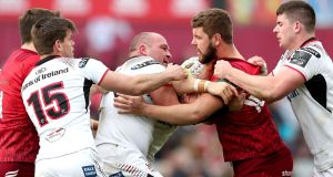 Tempers flare between Ulster's Rory Best and Rhys Marshall of Munster during the Guinness Pro 14 game at  Thomond Park. Photograph: Billy Stickland/Inpho