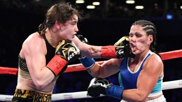 Katie Taylor catches Victoria Bustos with a left hook durnig her victory in New York. Photograph: Matt Heasley/Inpho