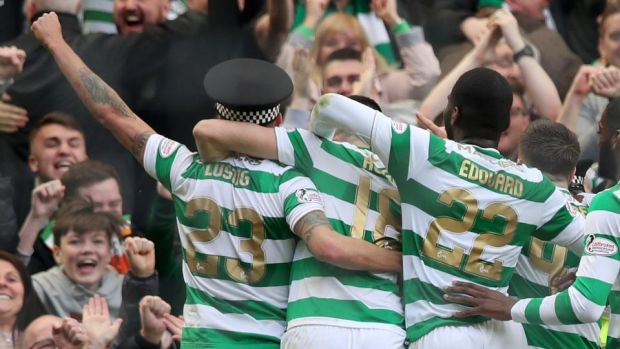 Mikael Lustig celebrates Celtic's third goal against Rangers. Photograph: Ian MacNicol/Getty