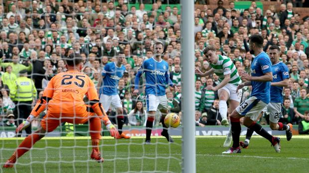 Celtic's James Forrest scores his side's third in their 5-0 thrashing of Rangers. Photograph: Jane Barlow/PA