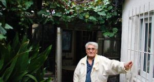Mehmet Ali outside his three-room home in Okmeydani district, Istanbul. Photograph: Stephen Starr