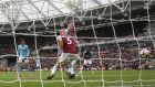 West Ham United's Pablo Zabaleta scores an own goal and the second for Manchester City. Photograph: Reuters