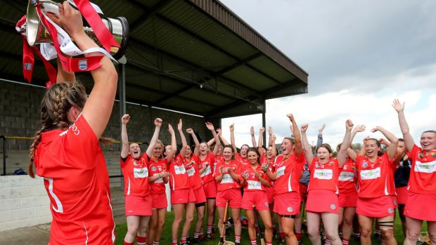 Cork's Sarah Harrington lifts the Littlewoods Ireland Camogie League 2 trophy at St Lachtain's GAA, Co Kilkenny on Sunday. Photograph: Bryan Keane/Inpho